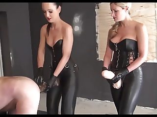 Two Mistresses use giant strapons to fuck their slave
