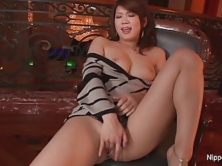Shy Asian babe fingers her pussy for the camera