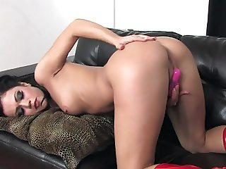 Mandy masturbating in panties and latex boots