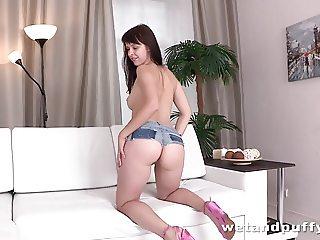 Long haired brunette dildoing her sweet snatch