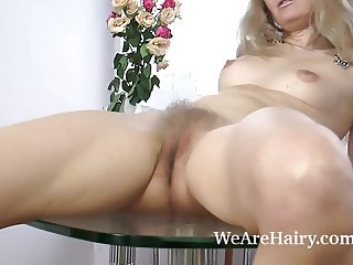Foxy masturbates with balls and fingers today