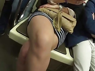 Beauty legs of mature girl in the train