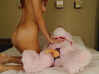 Redhead Teen Rides Dildo On Teddy Bear