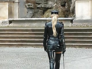 Sexy blonde lady shiny black policewoman