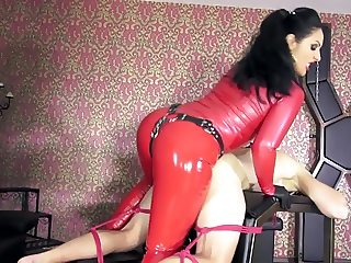 Bound slave facefucked & straponized by red latex mistress