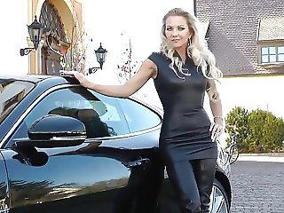 Blonde lady wearing sexy black leather