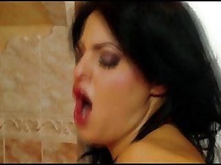 Brunette whore is on her knees sucking cock
