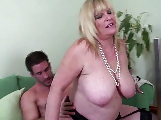 Big breasted old mom enjoying young big cock