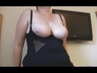 Busty mature BBW in stockings and tight dress