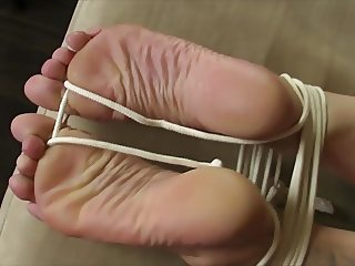 Tied, handcuffed, blindfolded and cummed soles.