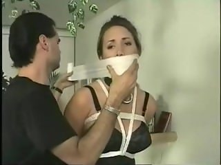 Andrea Neal bar tied and mouth bandaged