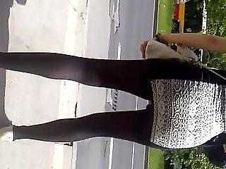 Ass in a short dress , pregnant girl