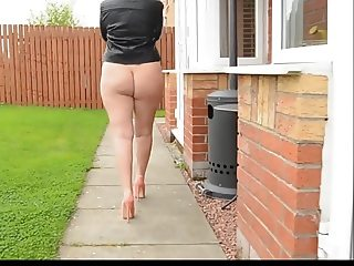 Mature woman outside comes with a bare ass.