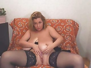 Rubs pussy with her huge tits