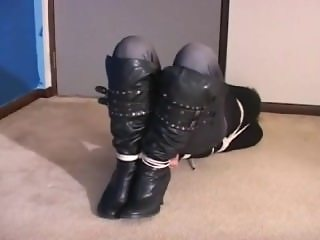 Carissa Montgomery in Boots and hogtied