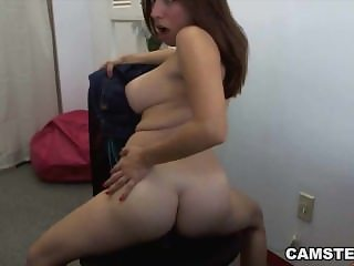 Masturbating on cam with her big tits out and legs wide open