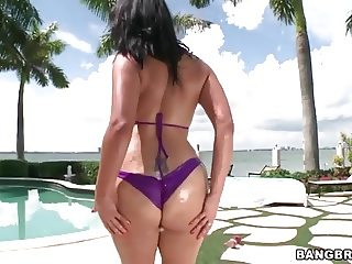 Oiled ass Miss Raquel gets pounded by the pool