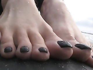 Sexy feet on the beach