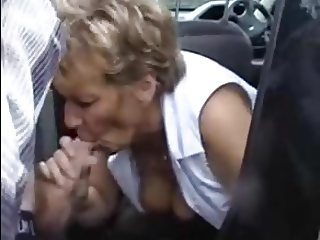 mature sucks young cock in car