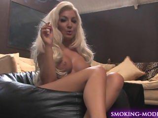 Hot blonde smoking topless
