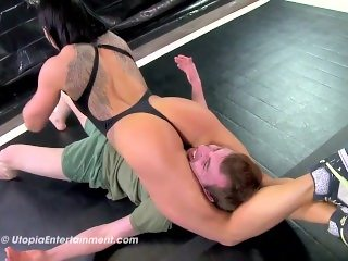 Fitness Girl in Thong Bodysuit Conquers Helpless Man in Mixed Wrestling