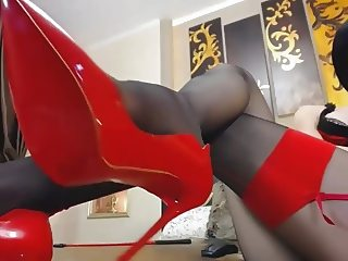 Girl in black pantyhose tease her red high heels