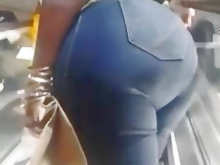 Big ass Ebony milf on escalator