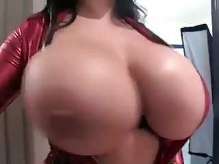 British brunette exposing her huge natural tits