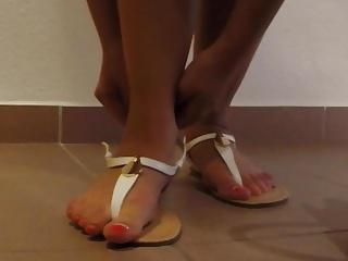Hot blonde girl's sandals cummed 2 - she puts them on!
