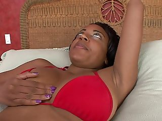 Ebony with huge tits rides white dick in bed