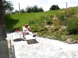 Blonde MILF in stockings sunbathing and more!