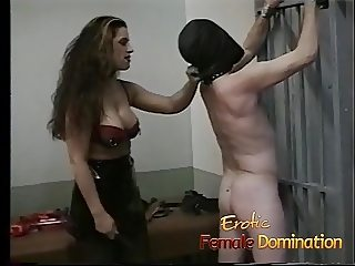 Sexy brunette interrogates a loser with her special bdsm