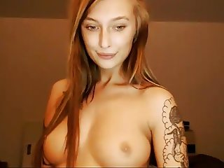 tattoo redhead from russia squirts and shows body on cam