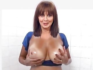 Carol oils her knockers