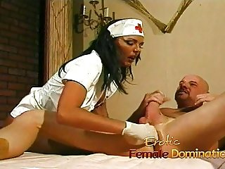 Busty nurse fucks her kinky patient with a giant strap-on