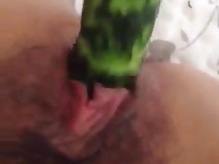 Mastubate with cucumber