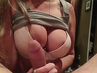 girl with glasses and nice tits plays with cock
