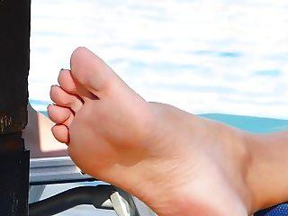 Beautiful nude feet at swimming pool
