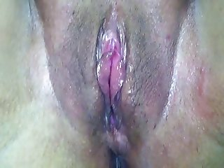 spreading her pussy