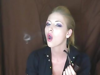 Sexy and sophisticated lady smoking her pipe
