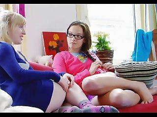 Two cute young lesbians enjoy each other