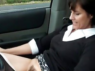 Sexy milf masturbates in car