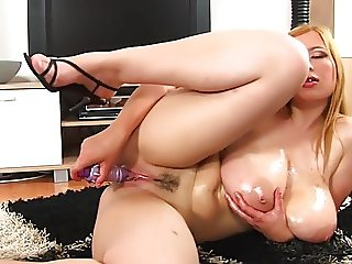 curvy cutie with giant natural boobs toying