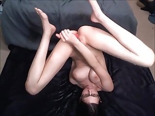 Webcam girl wearing glasses, and squirts on her own face