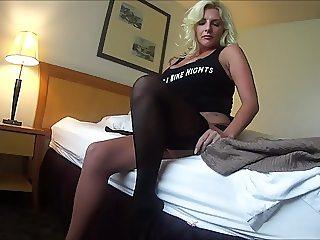 Big tit blonde puts on nylons