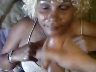 Covering an ebony mature face with my cum