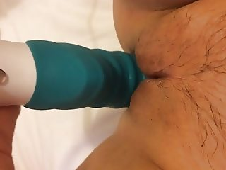 Big dildo in a tight pussy