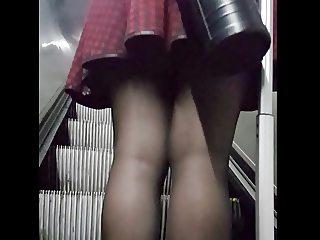 Groping shiny black pantyhose girl in metro and upskirt