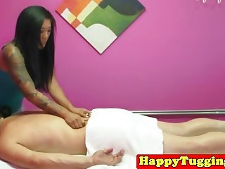 Tattooed asian jerking during massage